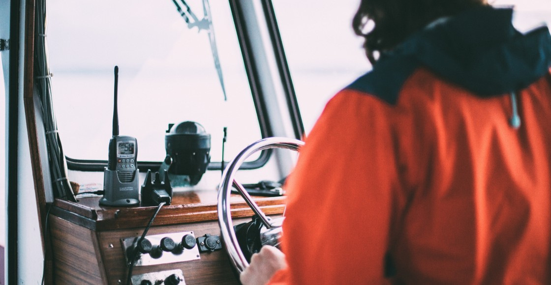 Captain driving a boat