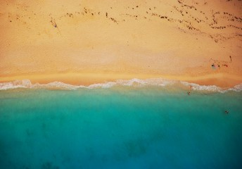 Aerial shot of a beach with blue water