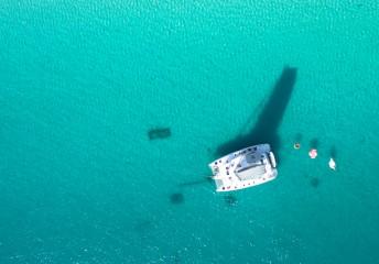 catamaran and sailboat