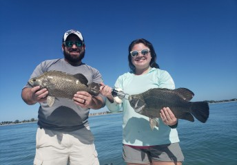 Father and daughter with tripletail in Florida - Catch Memories Boatsetter Fishing Giveaway