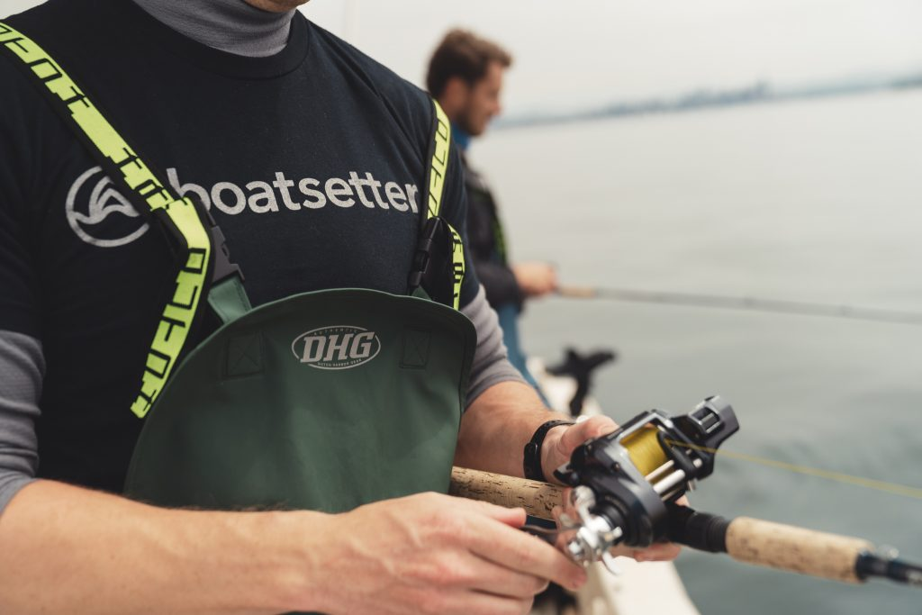 Angler wearing a Boatsetter shirt on a Seattle fishing charter