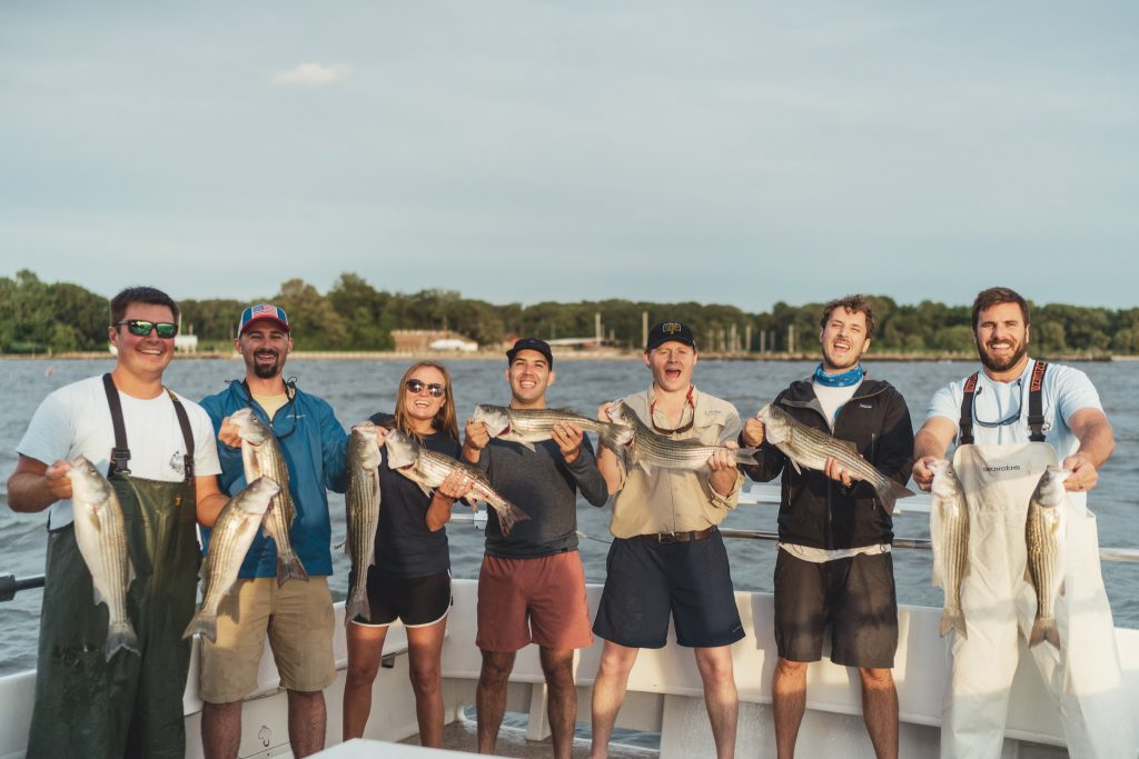 Anglers with striped bass on a fishing charter from Annapolis, Maryland